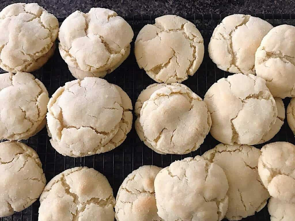 Baked sugar cookies on a cooling rack.