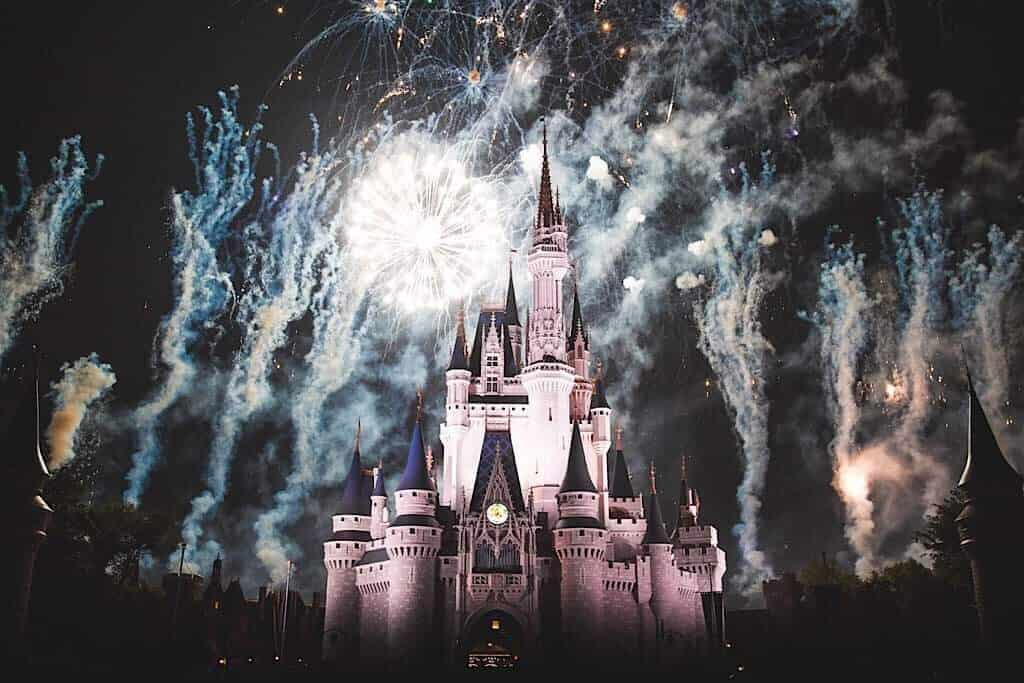 Fireworks exploding over the castle at Disney World