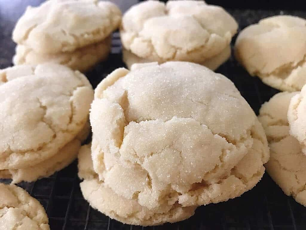 Close up photo of sugar cookies on a cooling rack.