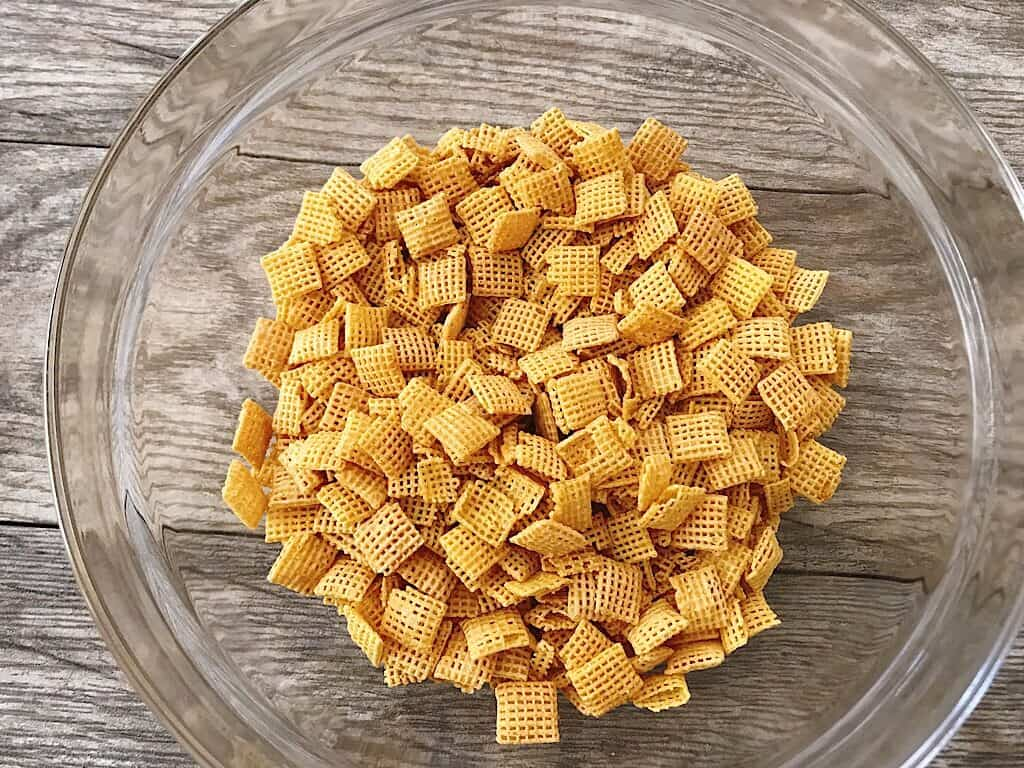 A glass bowl of Chex cereal.
