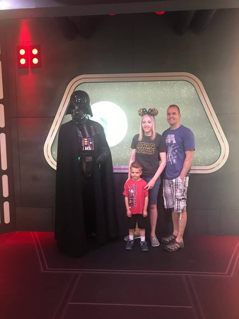 Darth Vader with a Mom, Dad, and little boy at Disneyland.