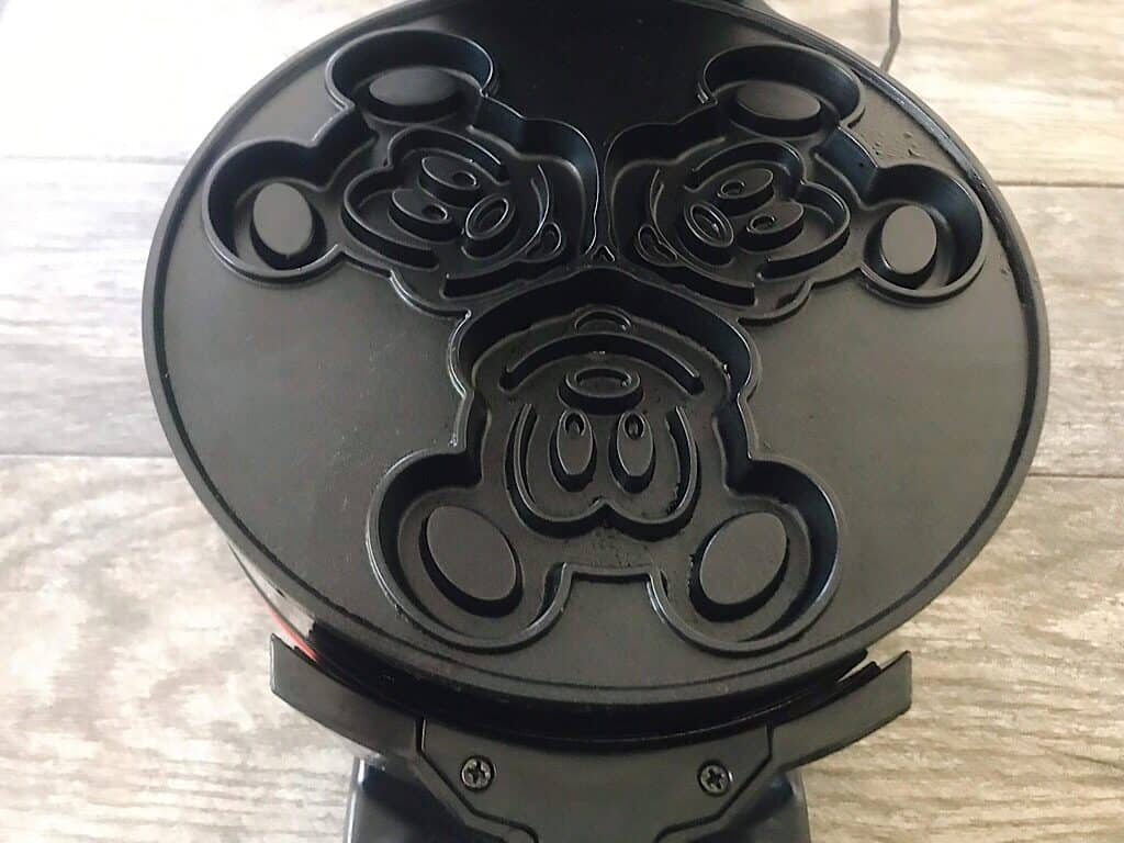 The inside of a Mickey Mouse Waffle Iron.