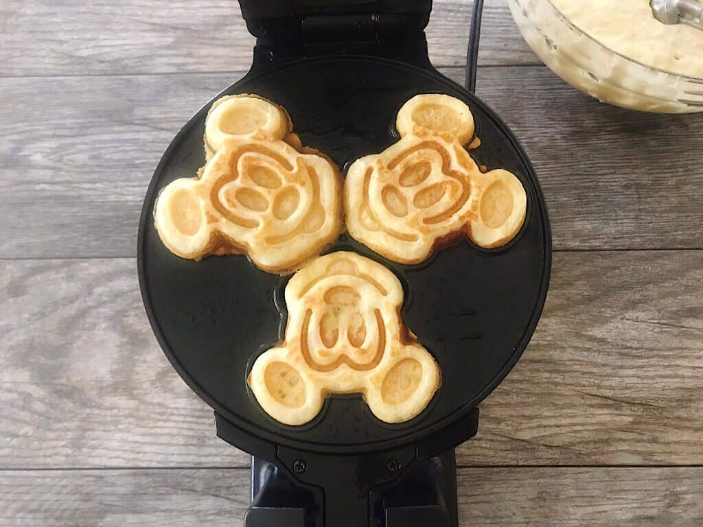 Crispy waffles in a Mickey Mouse waffle iron.