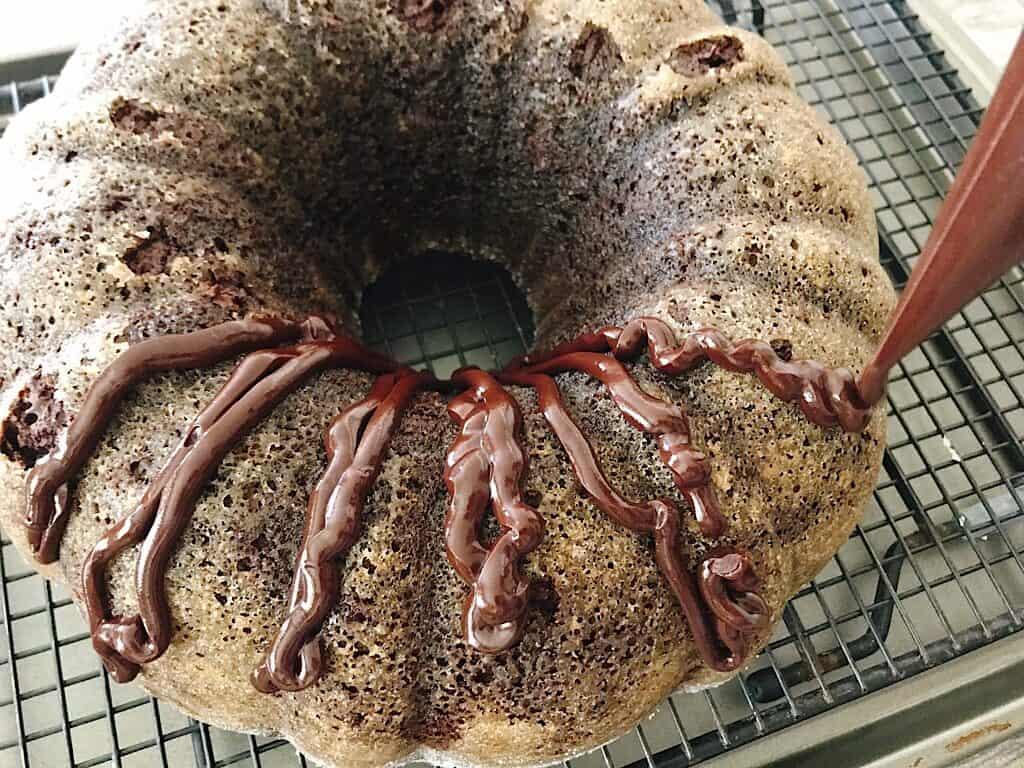 Ganache drizzled on a bundt cake