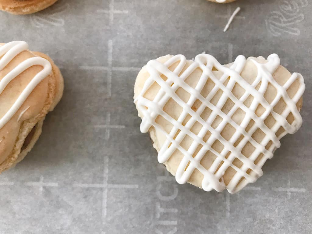 White chocolate drizzled on a macaron