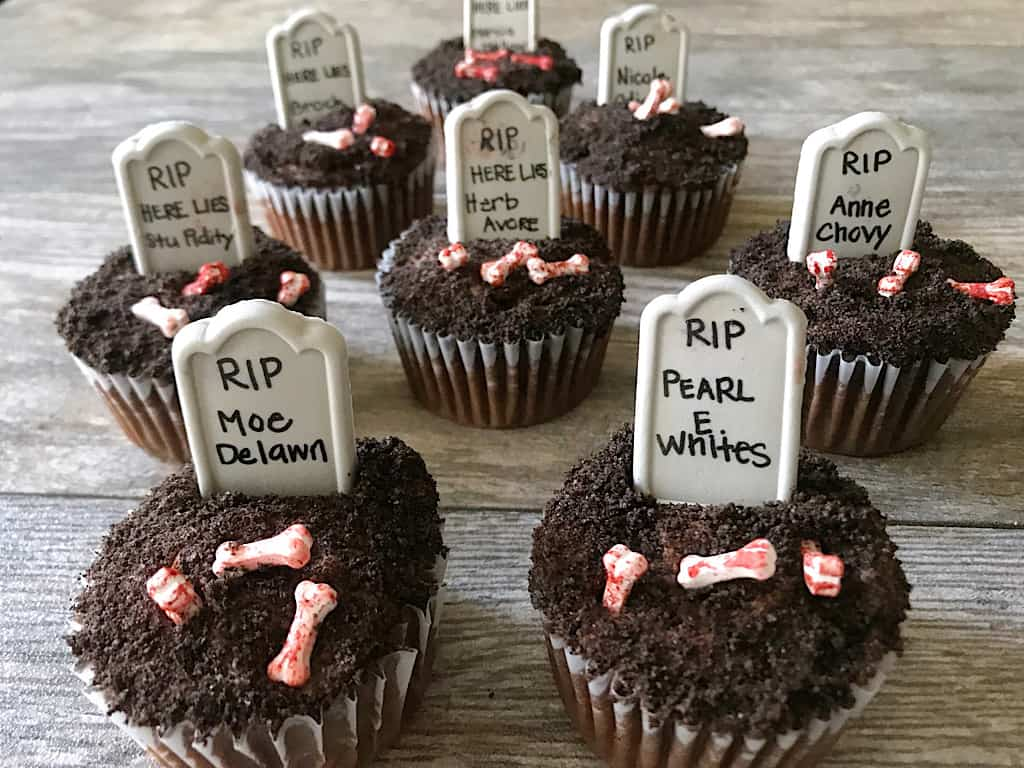 Graveyard cupcakes with candy bones and candy tombstones with funny names