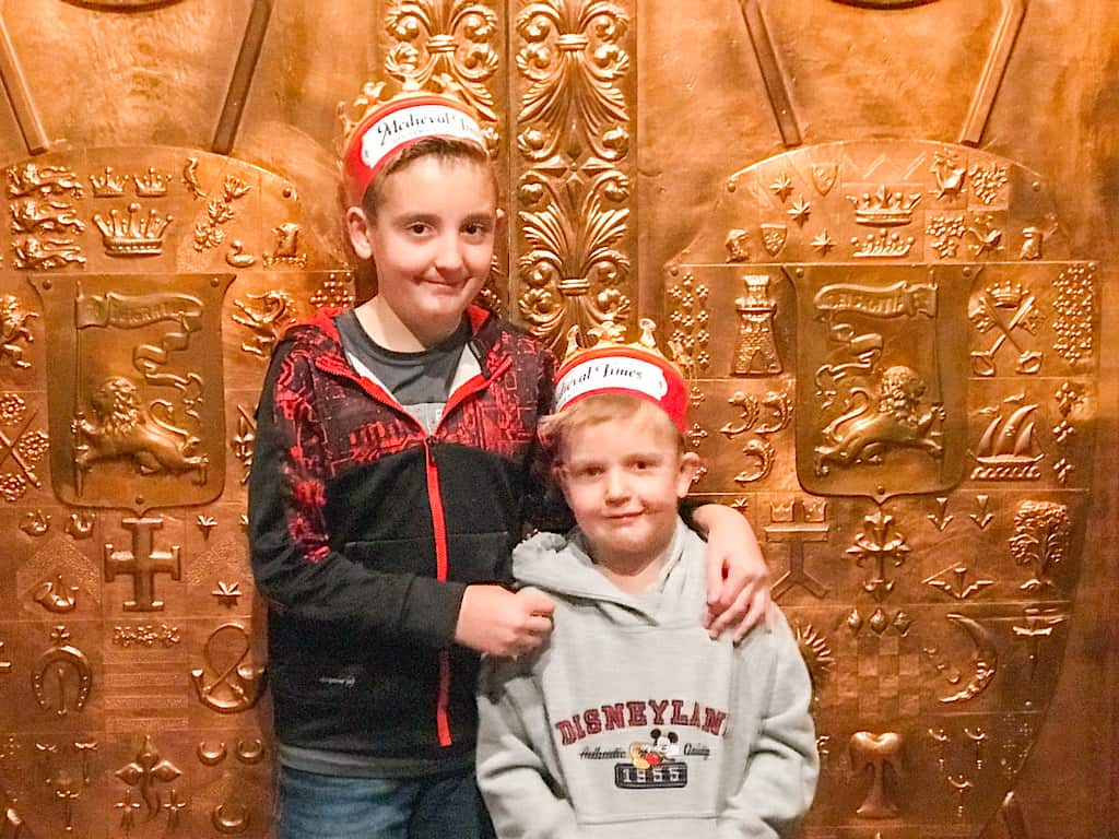 Two kids in crowns for the Medieval Times dinner show in Buena Park California