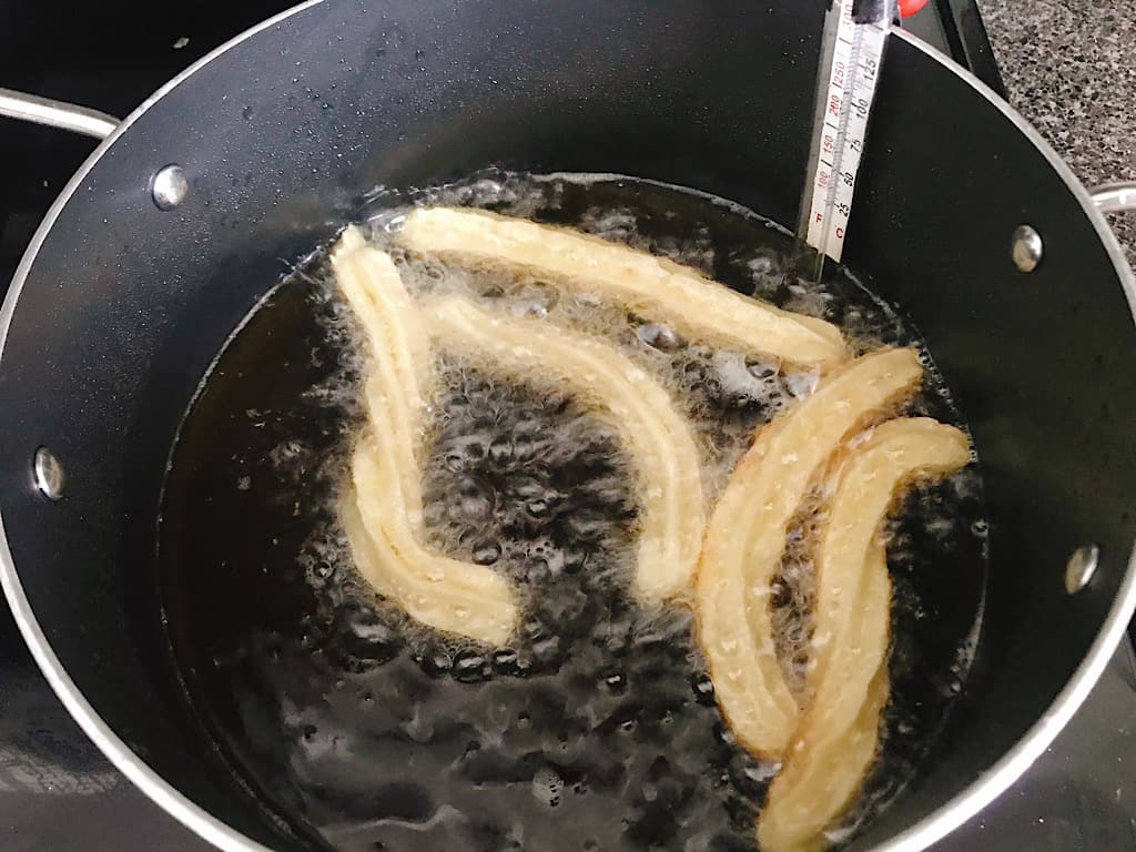 Christmas Disneyland Churros frying in oil.