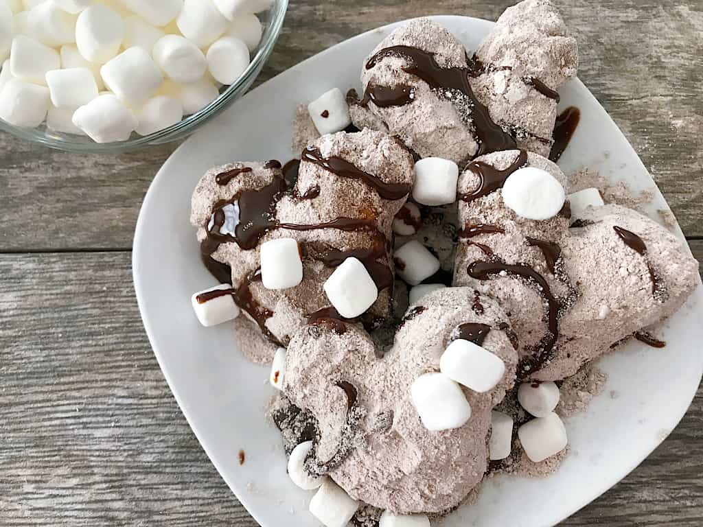 Mickey Beignets with hot chocolate, hot fudge, and marshmallows.