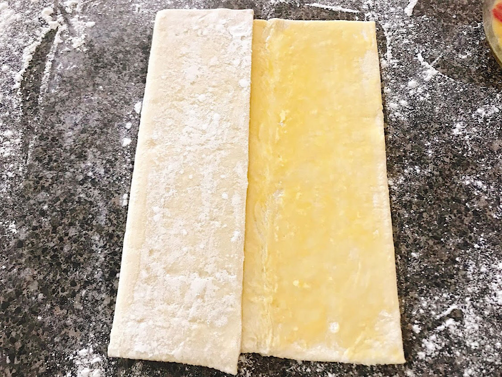 Puff pastry dough folded to make cronuts