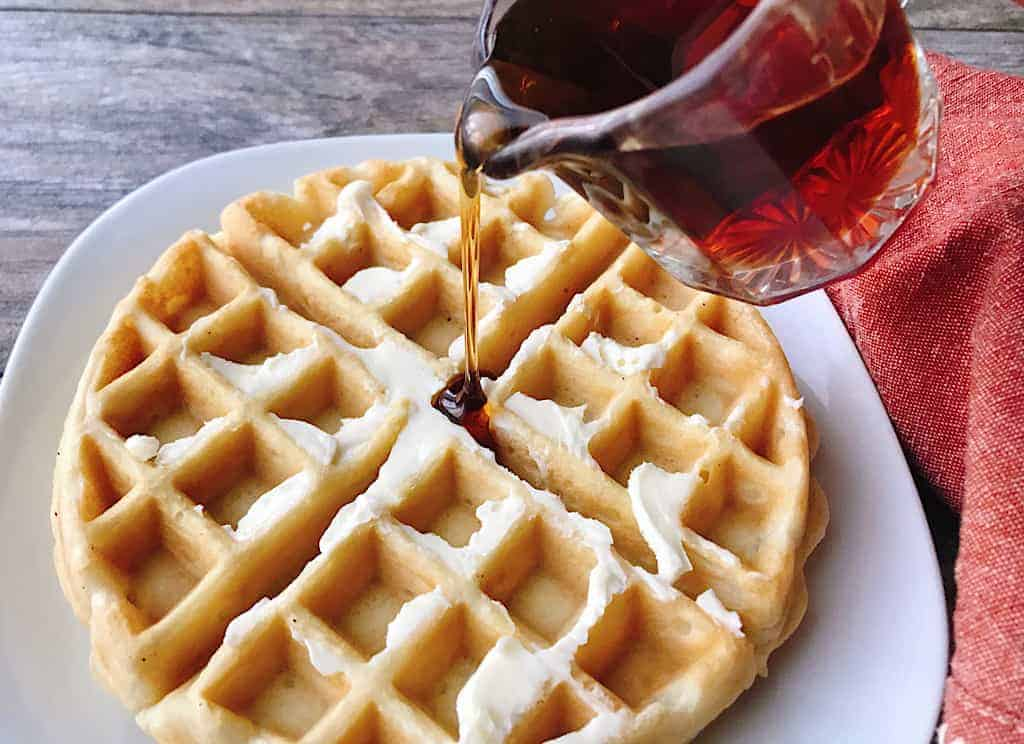 Syrup poured on a waffle