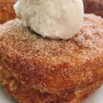 A homemade cronut topped with vanilla ice cream.