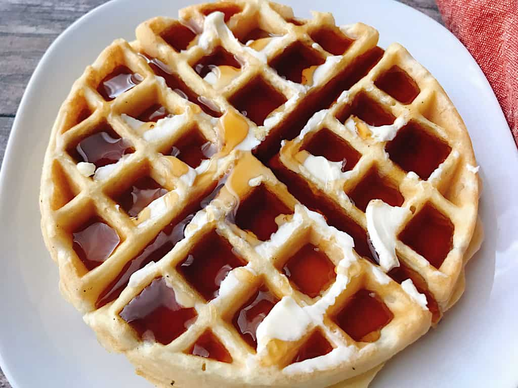An easy fast waffle recipe with butter and syrup