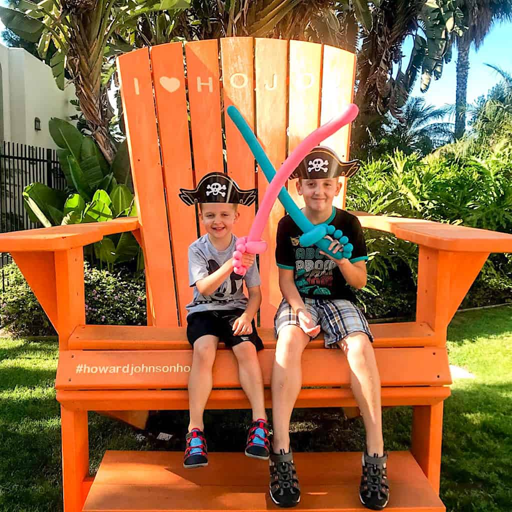 Two kids in pirate gear on the chair at Howard Johnson Anaheim