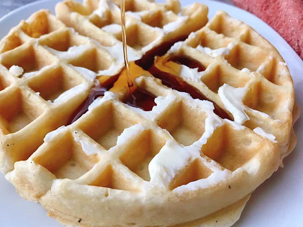 Syrup poured on an easy fast waffle.