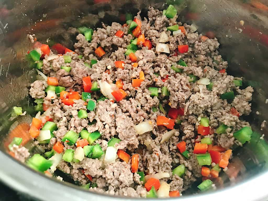 Sausage, ground beef, onions, and peppers in an Instant Pot
