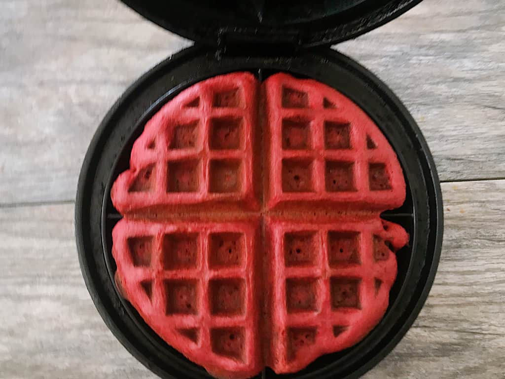 Red Velvet waffle in a waffle iron