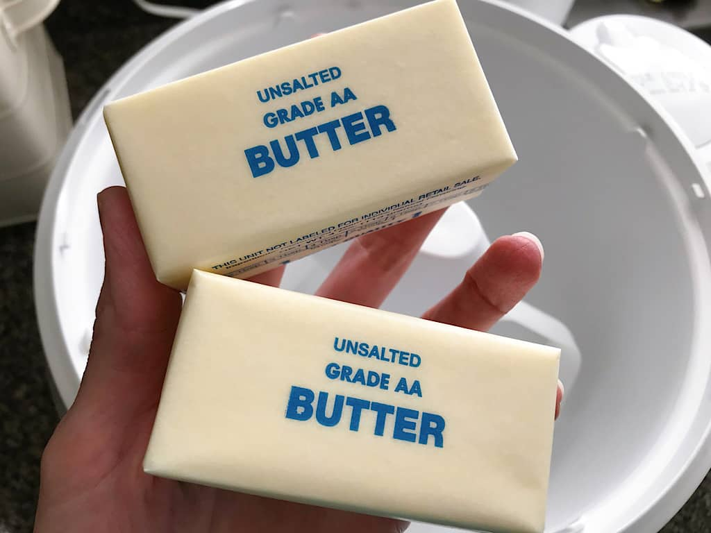 Two sticks of butter for strawberry frosting