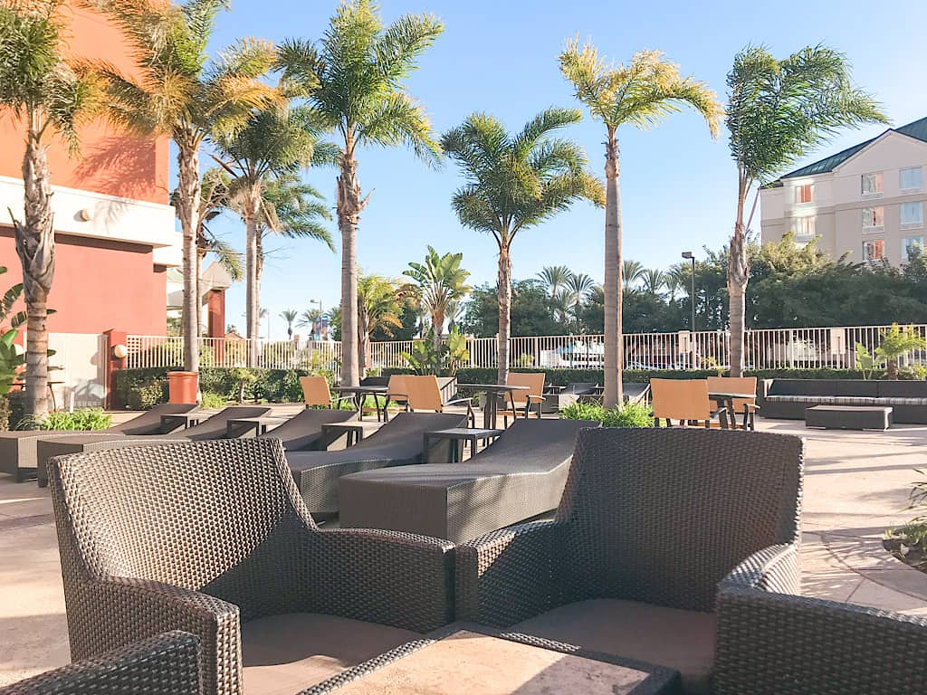 Outdoor seating area at Embassy Suites by Disneyland