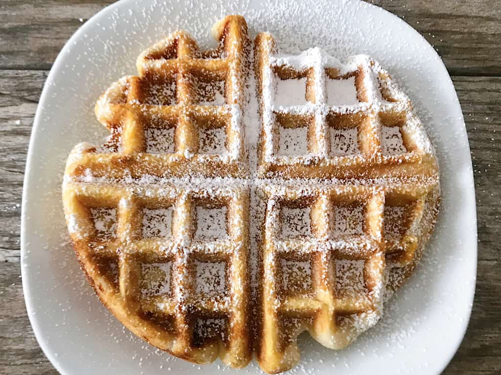 A funnel cake waffle with powdered sugar
