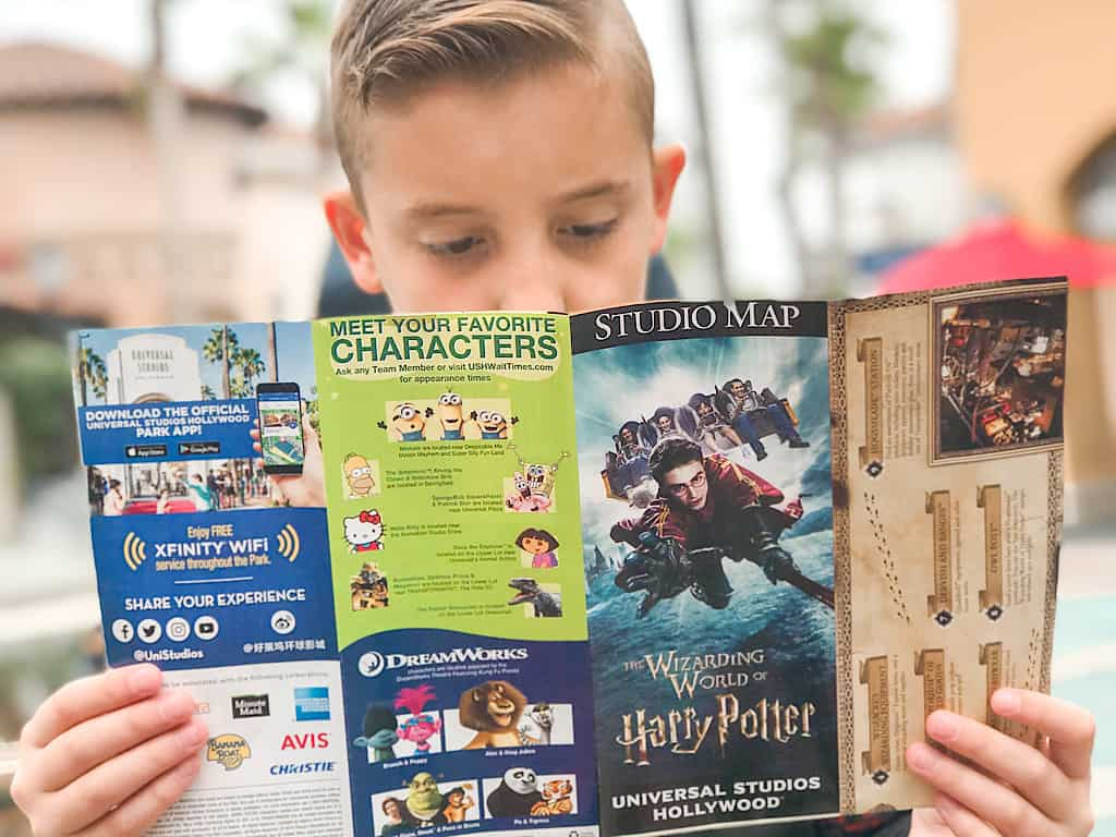 A boy reading a map of Universal Studios Hollywood