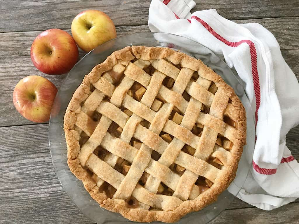 Caramel Apple Pie with 3 apples and a dish towel.