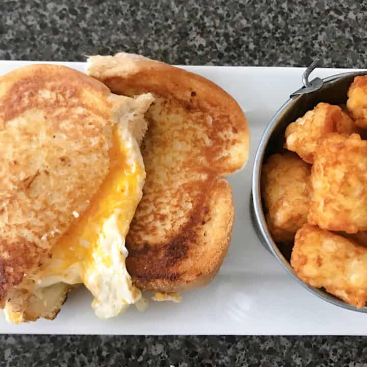 Woody's Lunchbox three cheese grilled cheese and tater tots
