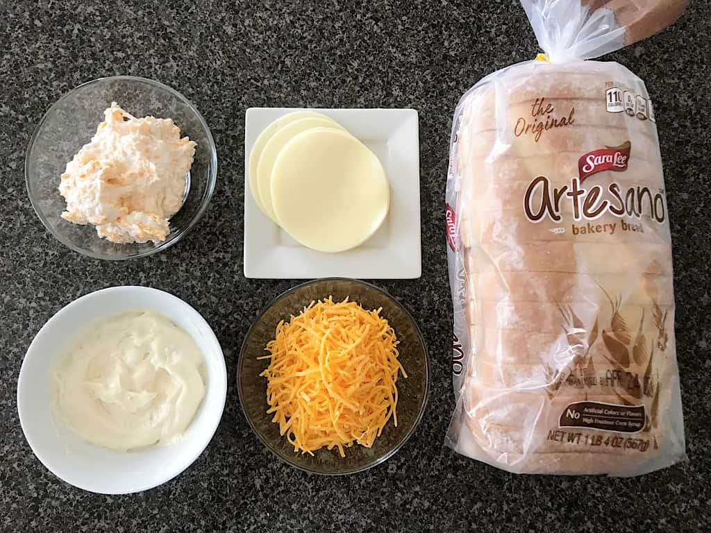 Cream cheese spread, garlic spread, provolone cheese, cheddar cheese, artisan bread for grilled cheese sandwich