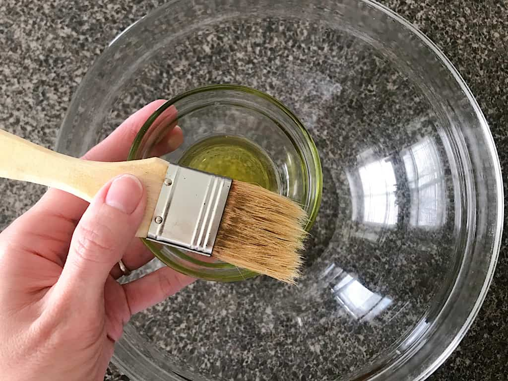 Spray a large mixing bowl with cooking spray or coat in oil.