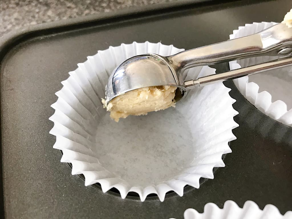 Sugar cookie dough scooped into cupcake liners
