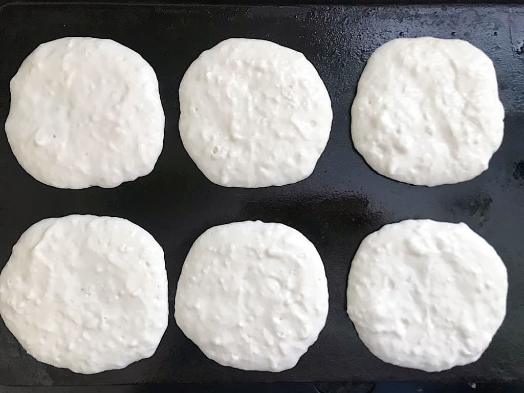Heat a griddle to 325 degrees and add 1/4 cup of batter for each pancake.