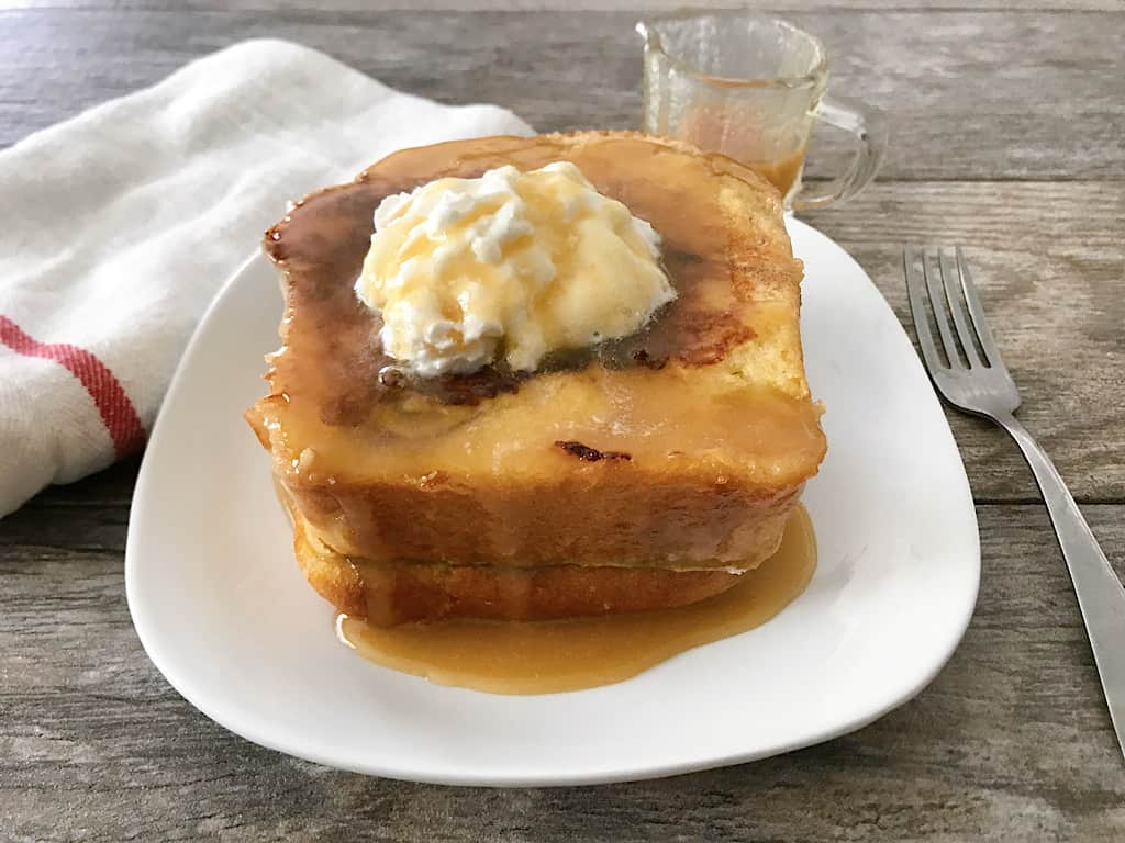 Kneader's French Toast, whipped cream and caramel syrup