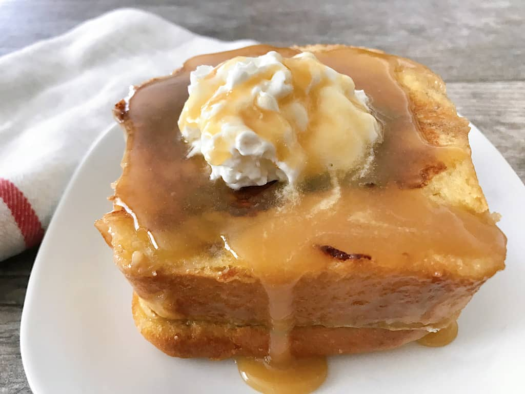 Kneader's French Toast with whipped cream and caramel syrup
