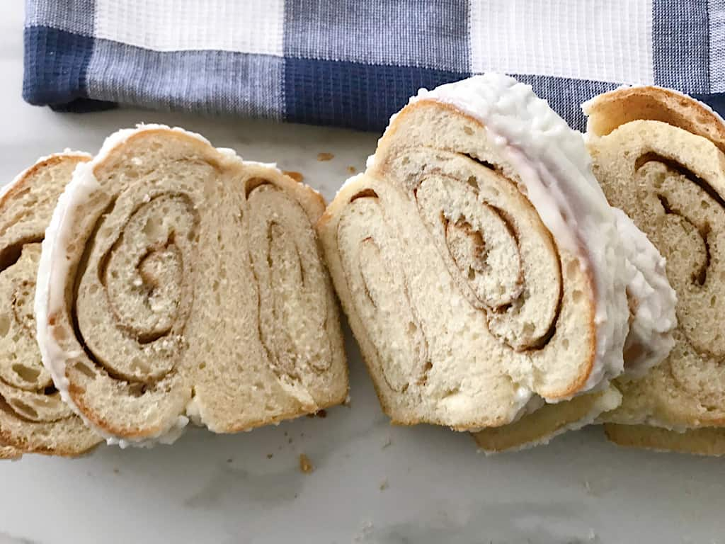 Slices of Copycat Kneader's Chunky Cinnamon Bread with icing