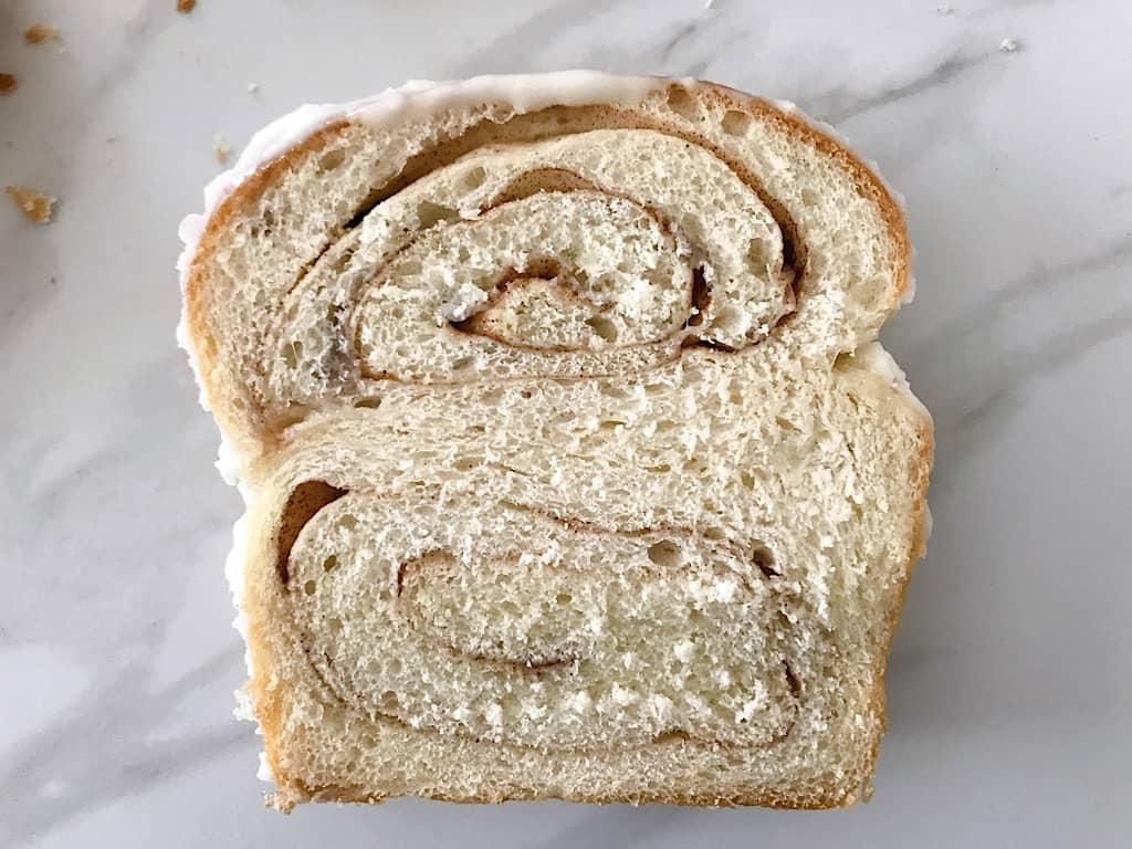 A slice of chunky cinnamon bread like Kneader's