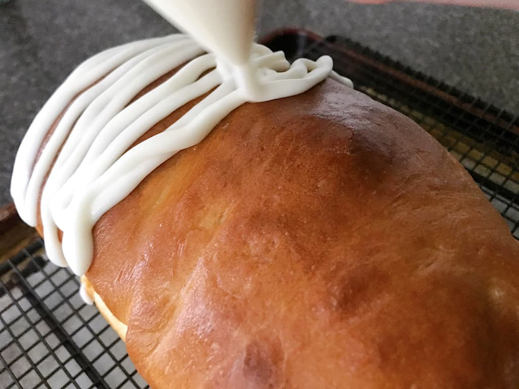 Glaze: Whisk together the powdered sugar and cream. Drizzle over the top of the bread.