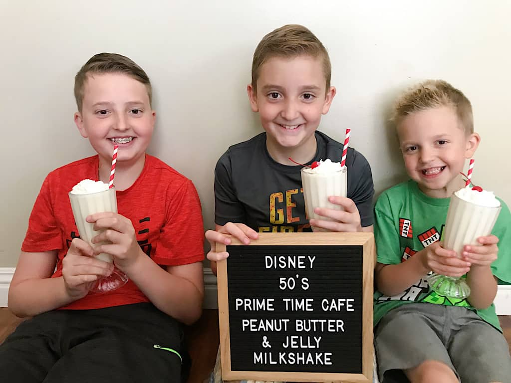Three kids drinking peanut butter and jelly milkshakes
