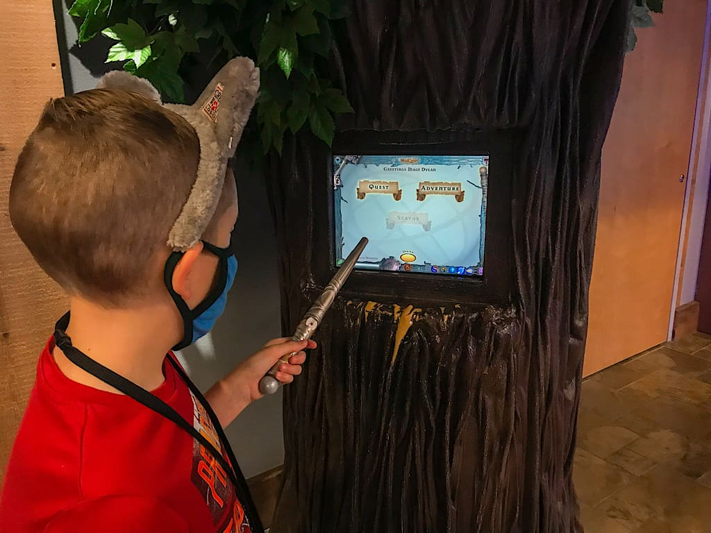 A child with Wolf Ears and a wand playing MagiQuest at Great Wolf Lodge