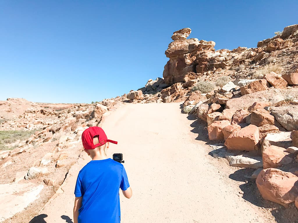 Kids on a hike to Delicate Arch