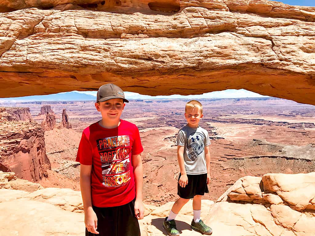 Kids at Mesa Arch in Canyonlands National Park
