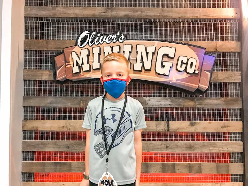 A boy standing in front of Oliver's Mining Co at Great Wolf Lodge Grand Mound, Washington
