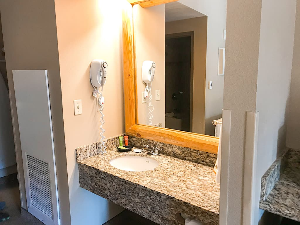 Sink and mirror in main room of Grand Bear Suite at Great Wolf Lodge
