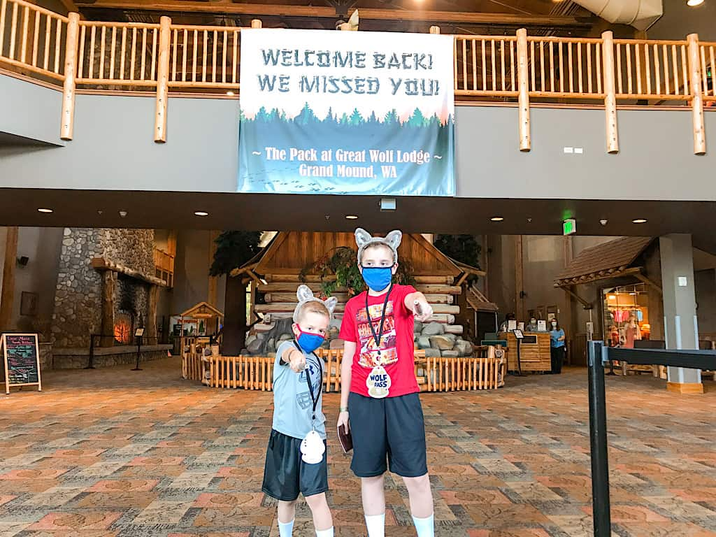 Two kids in the lobby of Great Wolf Lodge Washington