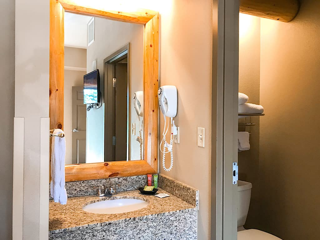 Vanity and half bath in Grand Bear Suite at Great Wolf Lodge Washington