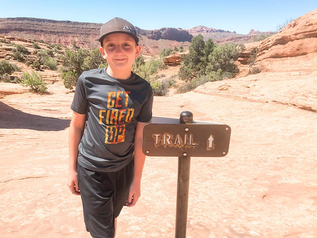 A boy on the trail to Delicate Arch at Arches National Park