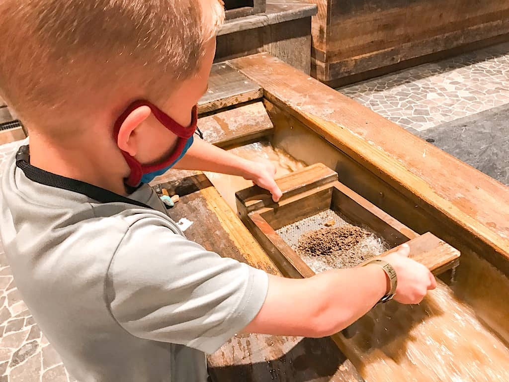 A boy panning for gems at Great Wolf Lodge