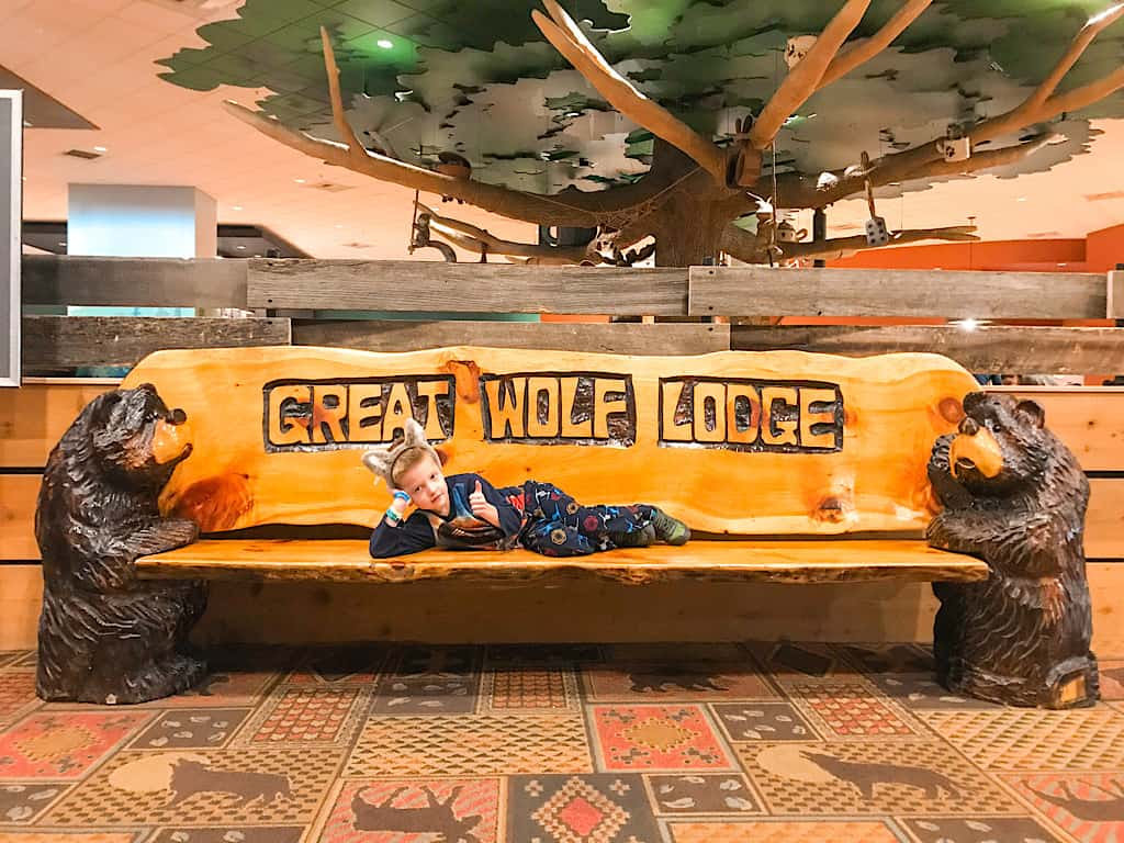 A child on a Great Wolf Lodge bench