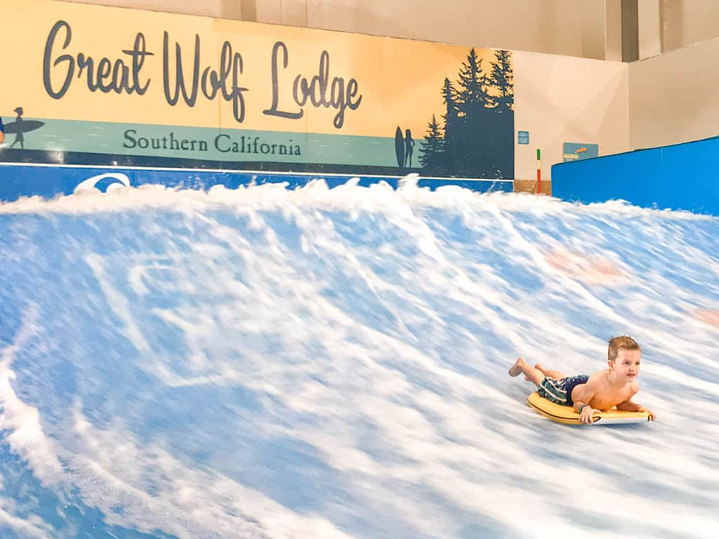 A boy doing tricks on a flow rider at Great Wolf Lodge Garden Grove