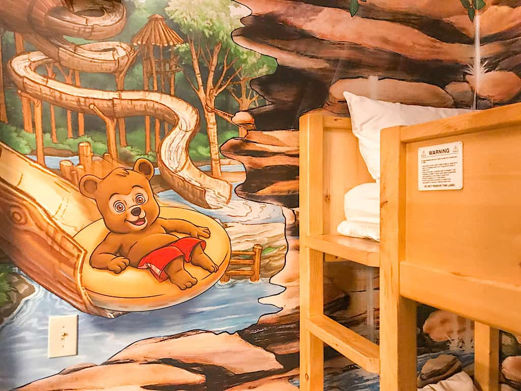 Bunk beds and mural in Wolf Den Suite