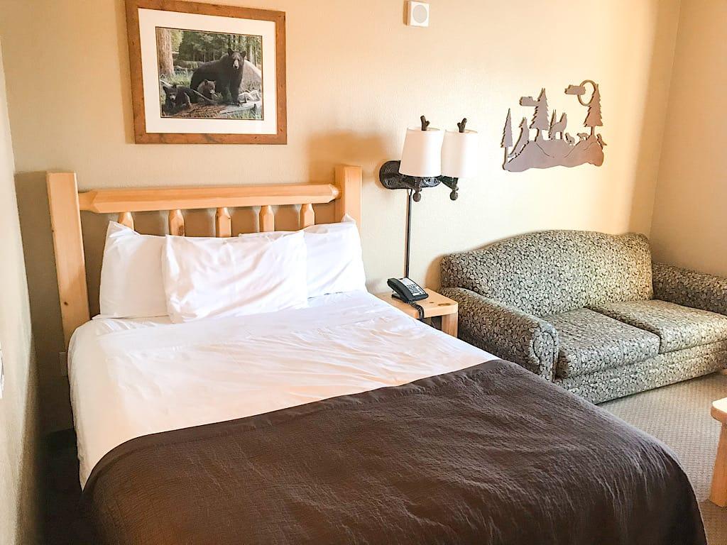 Queen bed and sofa sleeper in Wolf Den Suite